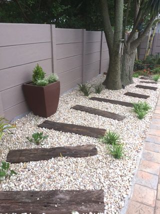 landscaping gravel path with railway sleepers pe